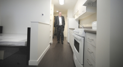 Rich Coleman, minister of natural gas development and housing, tours the Budzey Building, a newly completed structure providing 147 apartments for women or women with kids who are homeless or at risk of homelessness, in Vancouver on Thursday. Photograph by: NICK PROCAYLO , PNG